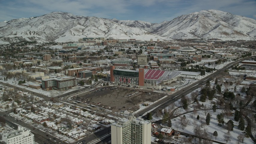 6K stock footage aerial video approach Rice-Eccles Stadium at the University of Utah in winter, Salt Lake City Aerial Stock Footage | AX126_048
