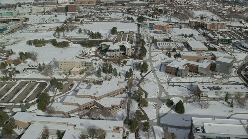 6K stock footage aerial video fly over snowy campus of the University of Utah, Salt Lake City Aerial Stock Footage | AX126_050