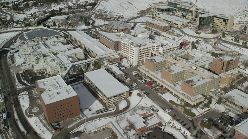 6K stock footage aerial video orbit University of Utah hospital with winter snow, Salt Lake City Aerial Stock Footage | AX126_052