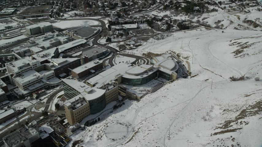 Orbit University of Utah Hospital Buildings with Winter Snow in Salt Lake City Aerial Stock Footage   AX126_053
