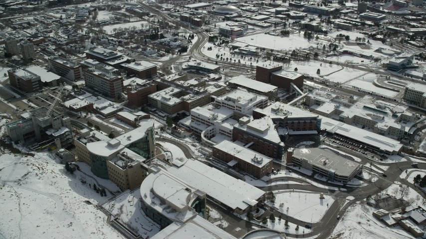 6K stock footage aerial video of circling University of Utah hospital buildings in wintertime, Salt Lake City Aerial Stock Footage | AX126_054