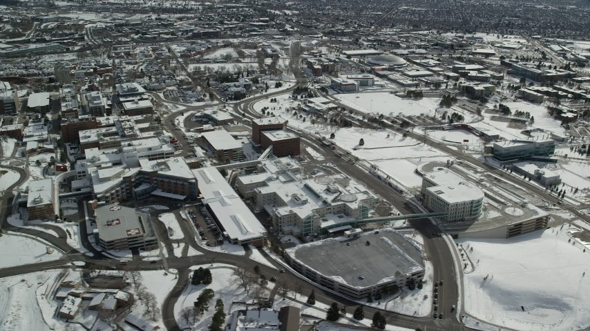 6K stock footage aerial video flyby the University of Utah with winter snow in Salt Lake City Aerial Stock Footage | AX126_055