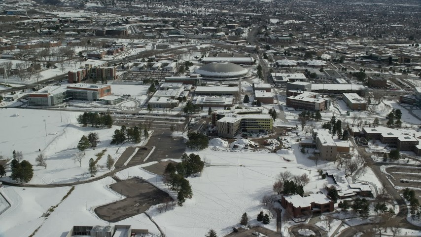 6K stock footage aerial video fly over University of Utah to approach the Jon M. Huntsman Center, Salt Lake City Aerial Stock Footage | AX126_057