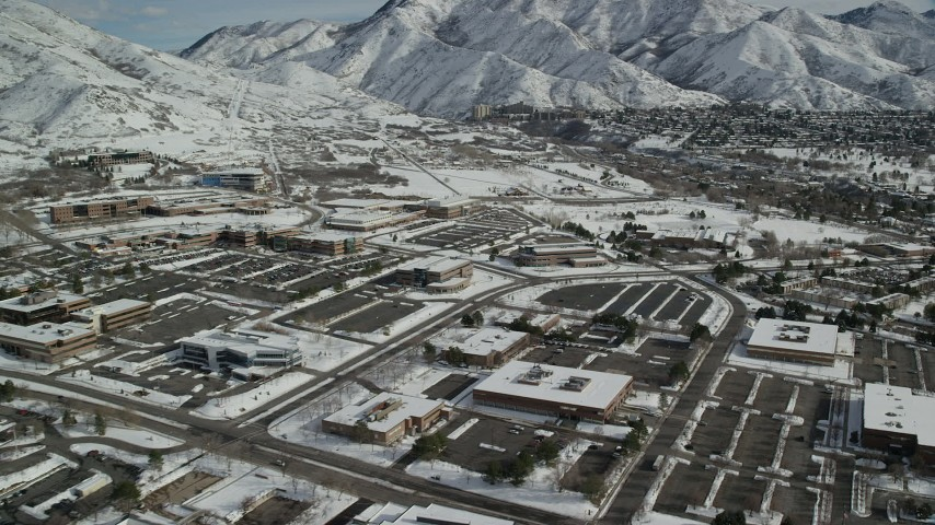 6K stock footage aerial video orbit office buildings in Salt Lake City with winter snow, Utah Aerial Stock Footage | AX126_060