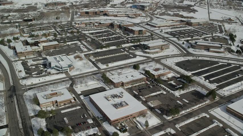 6K stock footage aerial video of orbiting Salt Lake City office buildings with winter snow in Utah Aerial Stock Footage | AX126_061