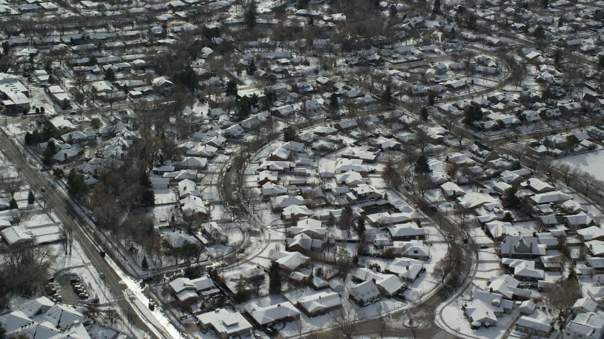 Orbit Salt Lake City Suburban Neighborhoods with Winter Snow Aerial Stock Footage | AX126_062