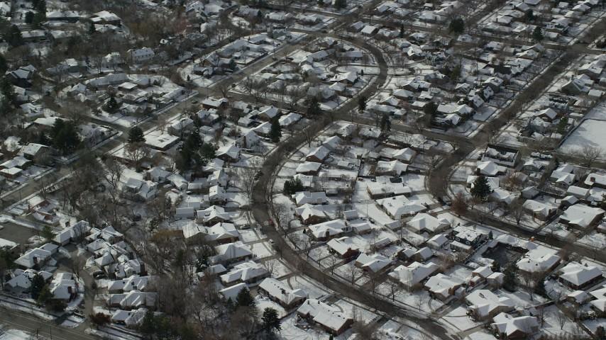 6K stock footage aerial video of orbiting Salt Lake City suburban homes in winter, Utah Aerial Stock Footage | AX126_063