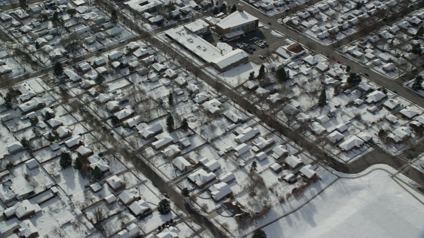 6K stock footage aerial video of a bird's eye view of homes with snow in Salt Lake City, Utah, in wintertime Aerial Stock Footage | AX126_064