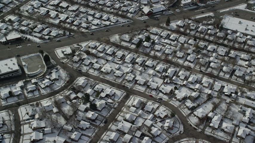 6K stock footage aerial video of circling above a residential neighborhood in Salt Lake City with winter snow, Utah Aerial Stock Footage | AX126_065