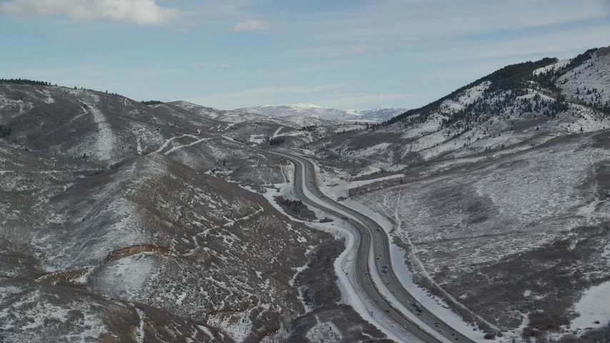 6K stock footage aerial video approach a freeway through the snowy Wasatch Range in winter, Utah Aerial Stock Footage | AX126_082