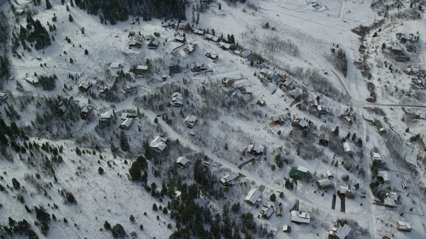 6K stock footage aerial video orbit upscale homes with winter snow in Park City, Utah Aerial Stock Footage | AX126_090