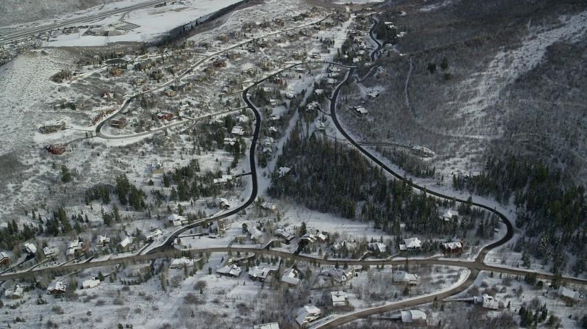 6K stock footage aerial video of orbiting upscale hilltop homes in snowy Park City, Utah Aerial Stock Footage   AX126_092