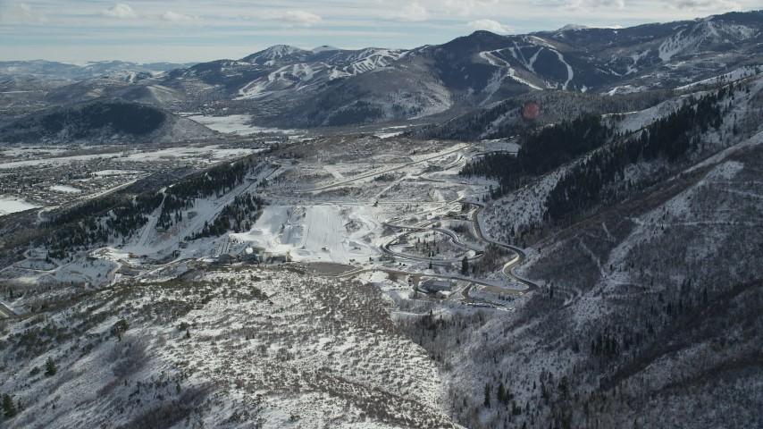 6K stock footage aerial video orbit Utah Olympic Park with winter snow in Park City, Utah Aerial Stock Footage | AX126_095