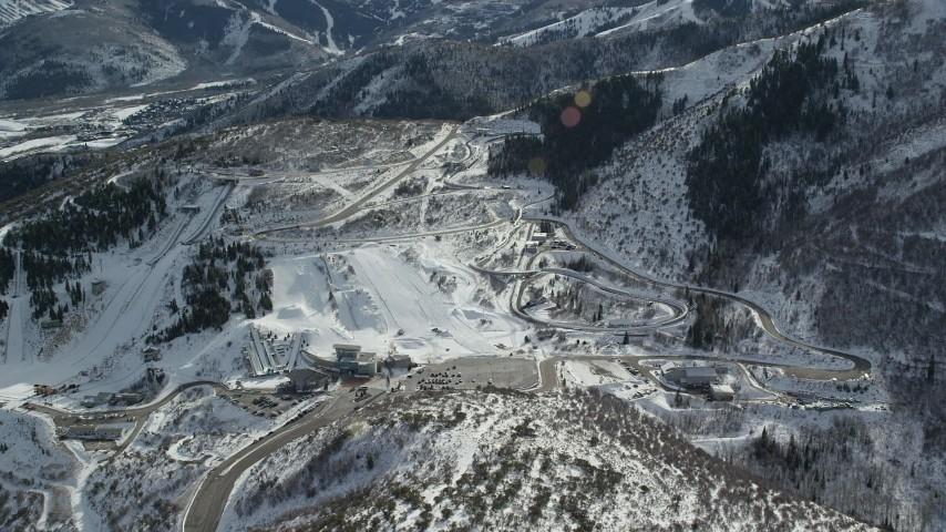 6K stock footage aerial video orbit of Utah Olympic Park with winter snow in Park City, Utah Aerial Stock Footage | AX126_096