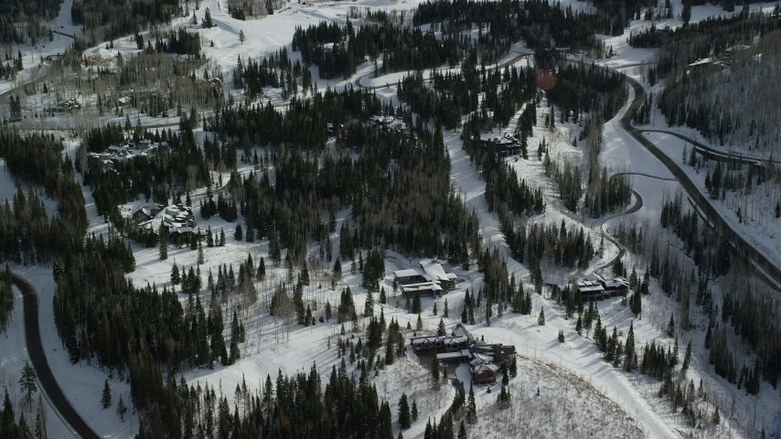 6K stock footage aerial video fly over mountainside mansions with winter snow in Park City, Utah Aerial Stock Footage | AX126_119