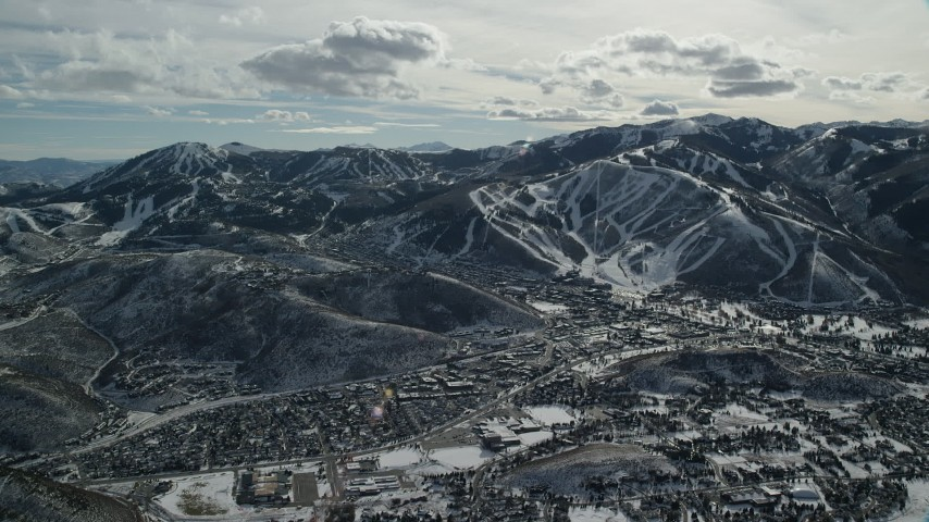6K stock footage aerial video orbiting the small town of Park City in winter, Utah Aerial Stock Footage | AX126_153