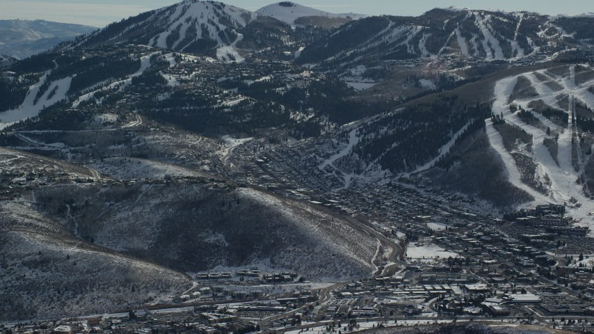 6K stock footage aerial video of small mountain town with winter snow in Utah's Park City Aerial Stock Footage   AX126_157