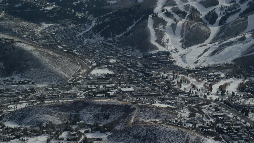 6K stock footage aerial video of small Utah mountain town with winter snow, Park City Aerial Stock Footage | AX126_158