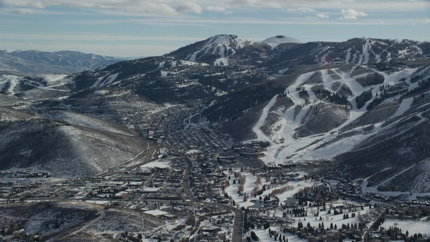6K stock footage aerial video orbit Park City and snowy mountain slopes with ski runs in winter, Utah Aerial Stock Footage | AX126_160