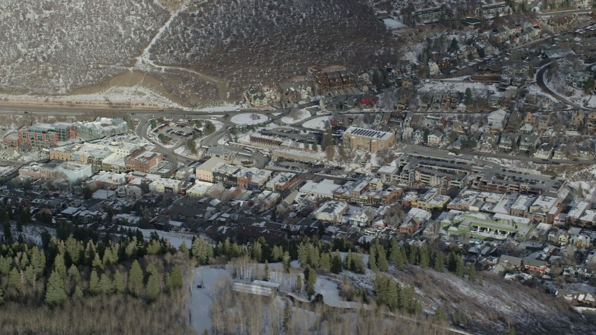 6K stock footage aerial video of center of Park City with winter snow, Utah Aerial Stock Footage   AX126_170