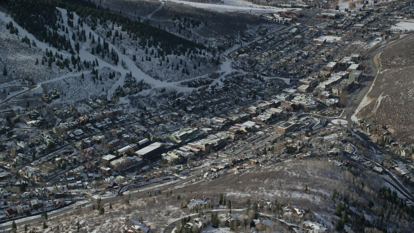 6K stock footage aerial video orbit the town of Park City with winter snow, Utah Aerial Stock Footage | AX126_174