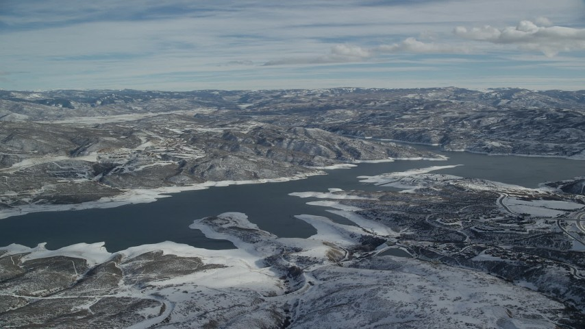 6K stock footage aerial video approach Jordanelle Reservoir near Heber City with winter snow, Utah Aerial Stock Footage | AX126_176