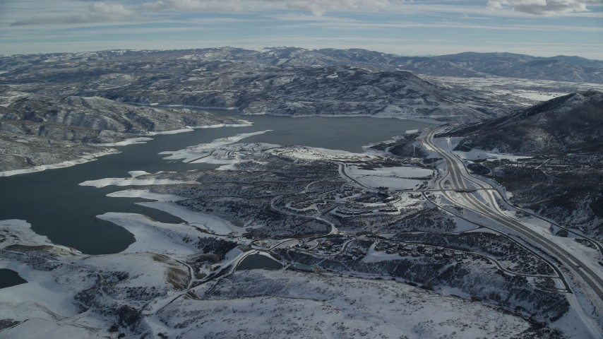 6K stock footage aerial video pan and approach condos near the Jordanelle Reservoir with winter snow, Heder City, Utah Aerial Stock Footage | AX126_177