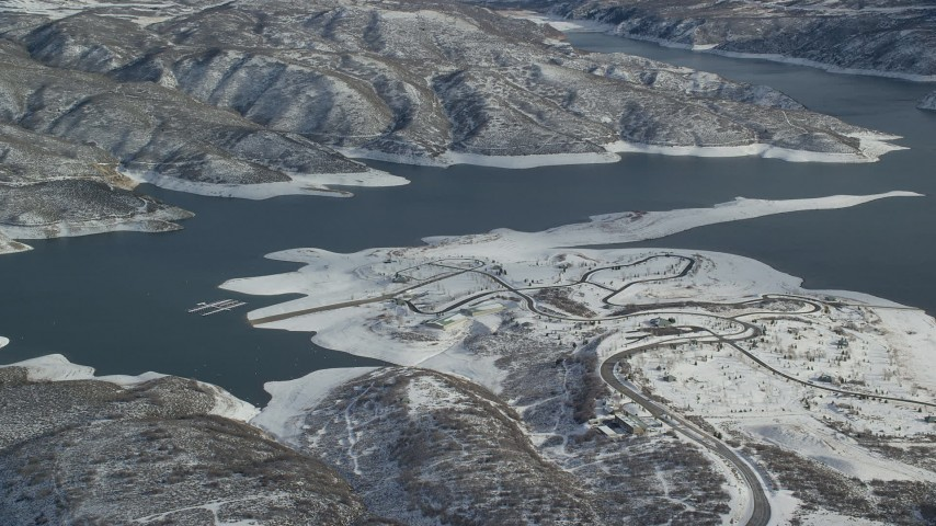 6K stock footage aerial video orbit roads near the shore of Jordanelle Reservoir in winter, Heber City, Utah Aerial Stock Footage | AX126_179