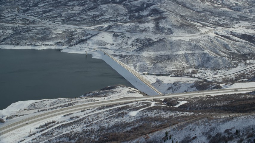 6K stock footage aerial video orbit dam on the Jordanelle Reservoir in wintertime, Heber City, Utah Aerial Stock Footage | AX126_181