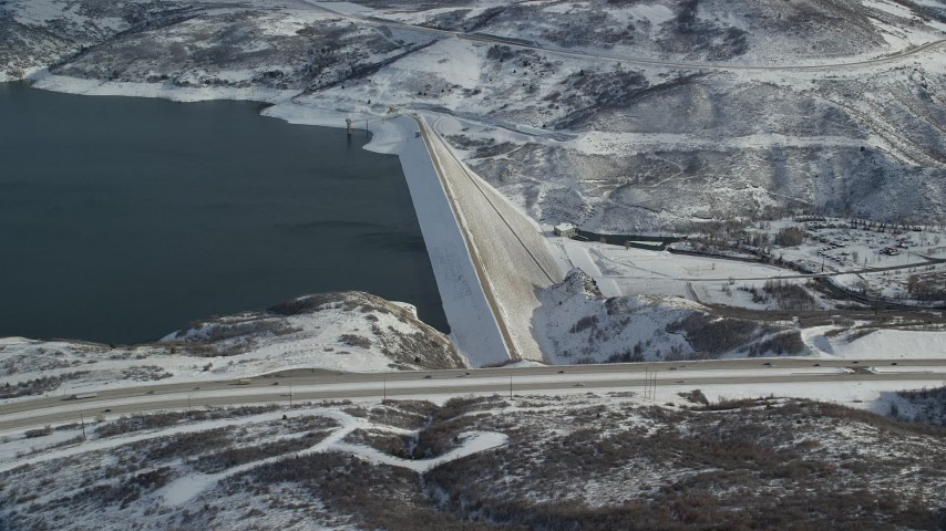 6K stock footage aerial video orbiting Jordanelle Dam with winter snow in Heber City, Utah Aerial Stock Footage | AX126_182