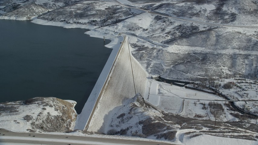 6K stock footage aerial video of slowly orbit the Jordanelle Dam with light winter snow, Heber City, Utah Aerial Stock Footage | AX126_183