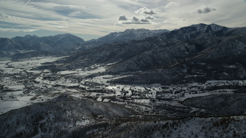 6K stock footage aerial video approach the small town of Midway with winter snow in Utah Aerial Stock Footage | AX126_199