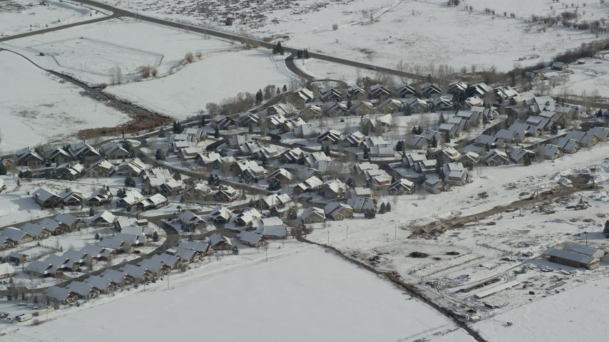 6K stock footage aerial video orbit tract homes in a small town neighborhood in Midway, Utah Aerial Stock Footage | AX126_202