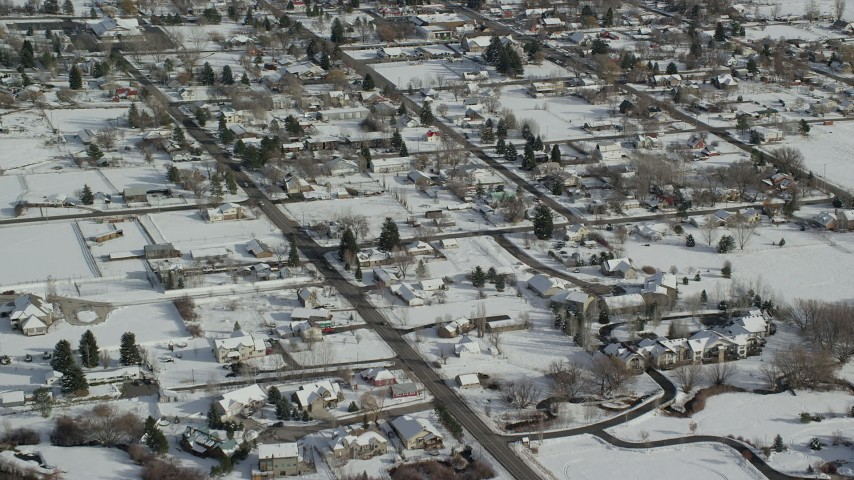 6K stock footage aerial video of flying over homes with snow on rooftops in winter, Midway, Utah Aerial Stock Footage | AX126_208