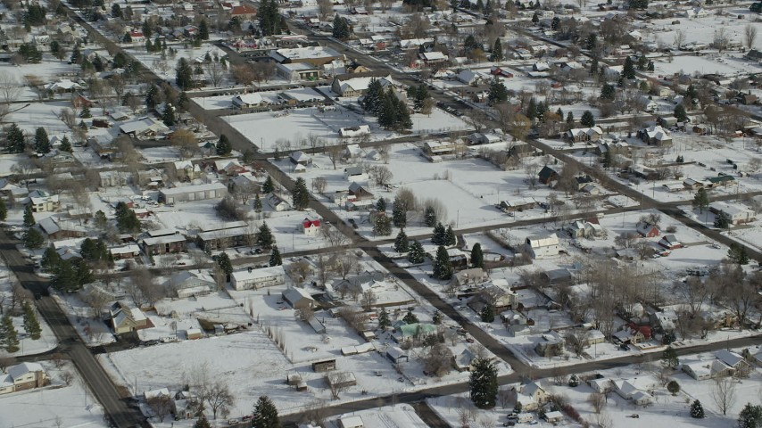 Fly Over a Small Town Neighborhood with Snow on the Ground in Midway Aerial Stock Footage | AX126_209