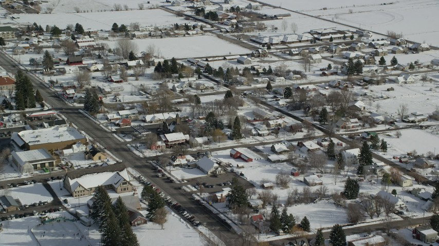 6K stock footage aerial video of flying over snowy small town neighborhoods in winter, Midway, Utah Aerial Stock Footage | AX126_210