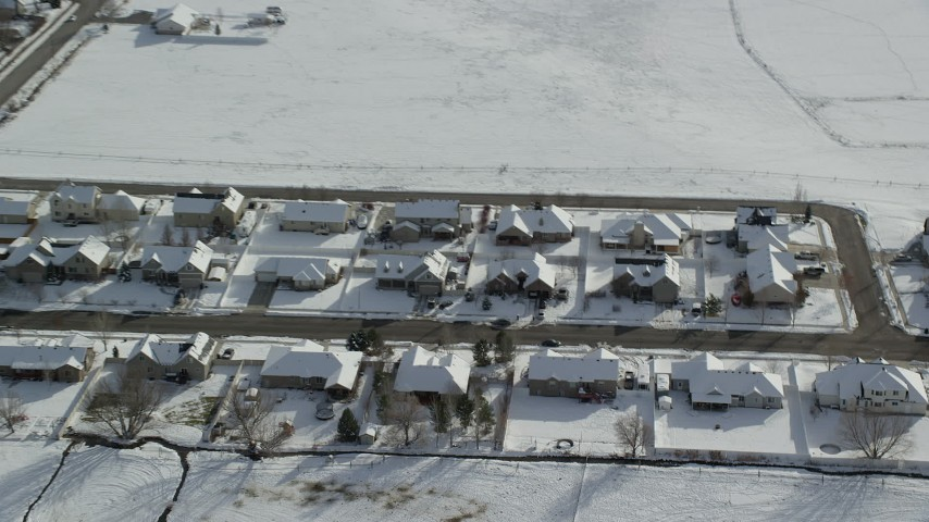 Orbit Rows of Tract Homes with Winter Snow on Rooftops in Utah Aerial Stock Footage | AX126_211
