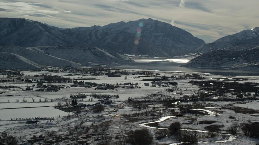 6K stock footage aerial video orbit Deer Creek Reservoir by Heber City with winter snow, Utah Aerial Stock Footage | AX126_213