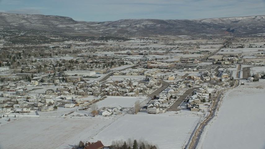 Orbit Homes with Winter Snow on the Outskirts of Heber City, Utah Aerial Stock Footage   AX126_215