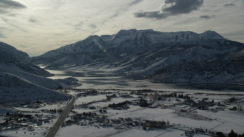 6K stock footage aerial video approach icy shore of Deer Creek Reservoir in winter, Heber City, Utah Aerial Stock Footage | AX126_221