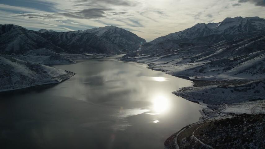 6K stock footage aerial video orbit sunlight reflected off Deer Creek Reservoir in wintertime, Utah Aerial Stock Footage | AX126_225