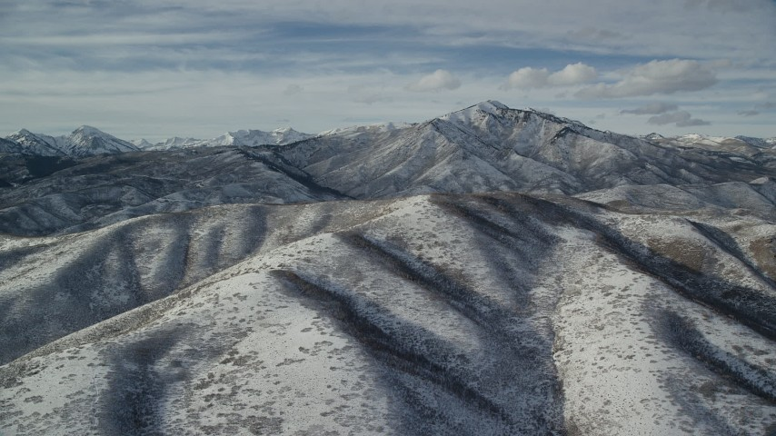 Orbit Snowy Mountain with Taller Peak in the Distance Aerial Stock Footage | AX126_232