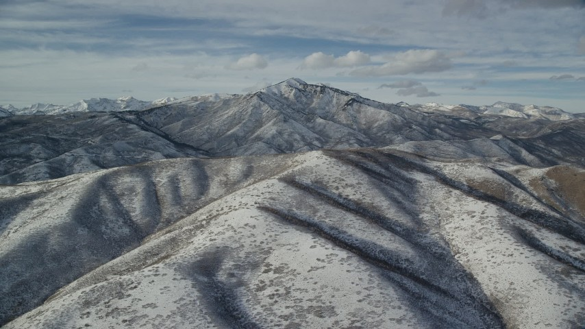 Orbit Snowy Mountain with Giant Peak in the Far Distance Aerial Stock Footage   AX126_233