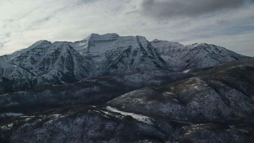 6K stock footage aerial video orbit rugged Mount Timpanogos with winter snow in the Wasatch Range of Utah Aerial Stock Footage | AX126_237