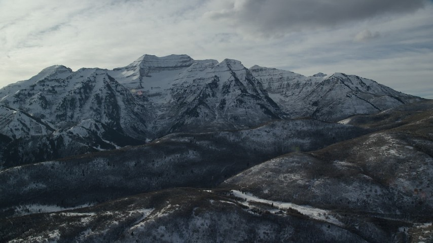 6K stock footage aerial video orbit tall, rugged Mount Timpanogos with winter snow in the Wasatch Range, Utah Aerial Stock Footage | AX126_238