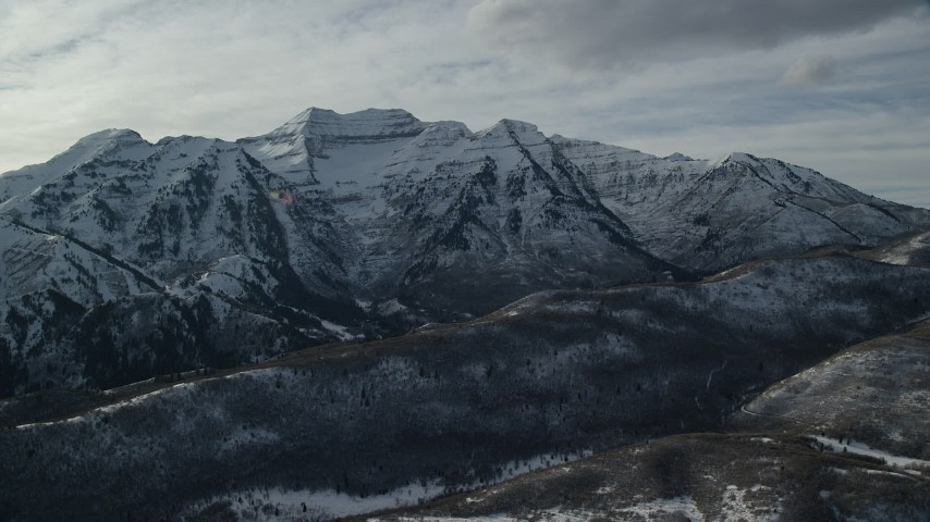 6K stock footage aerial video of jagged Mount Timpanogos with winter snow in Utah Aerial Stock Footage | AX126_239