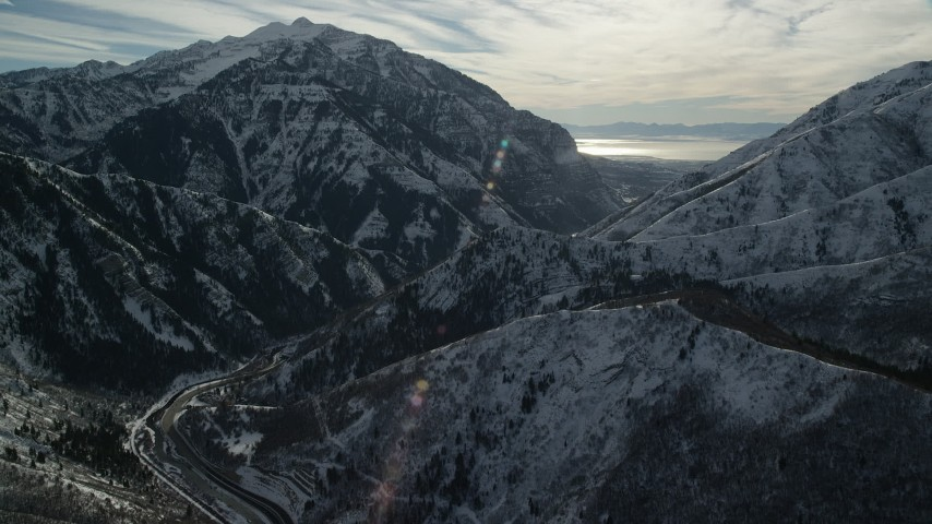 Approach Provo Canyon through Snowy Wasatch Range in Wintertime Aerial Stock Footage   AX126_240
