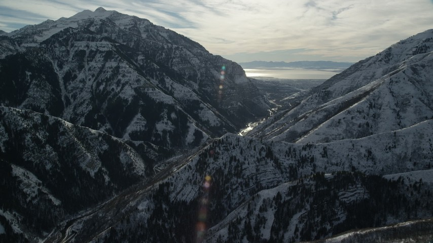 6K stock footage aerial video of approaching Provo Canyon through the snowy Wasatch Range in winter, Utah Aerial Stock Footage | AX126_241