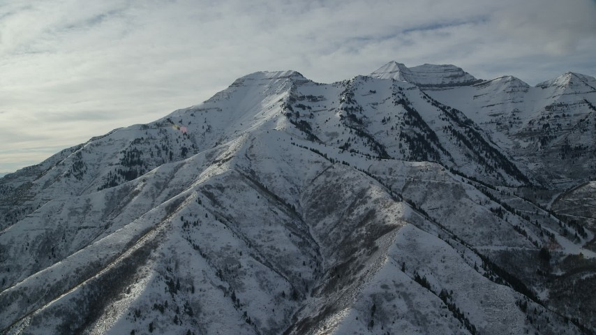 6K stock footage aerial video of orbiting tall Mount Timpanogos with winter snow in Utah Aerial Stock Footage | AX126_243