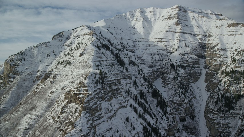 6K stock footage aerial video flyby steep, snowy slopes of Mount Timpanogos in winter, Utah Aerial Stock Footage | AX126_251